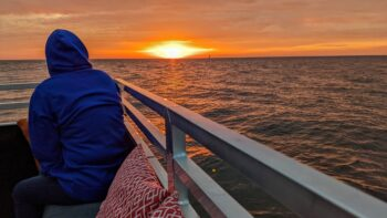 Woman watching the sunset aboard The Flying Dutchman, one of the best things to do in Saugatuck Michigan.