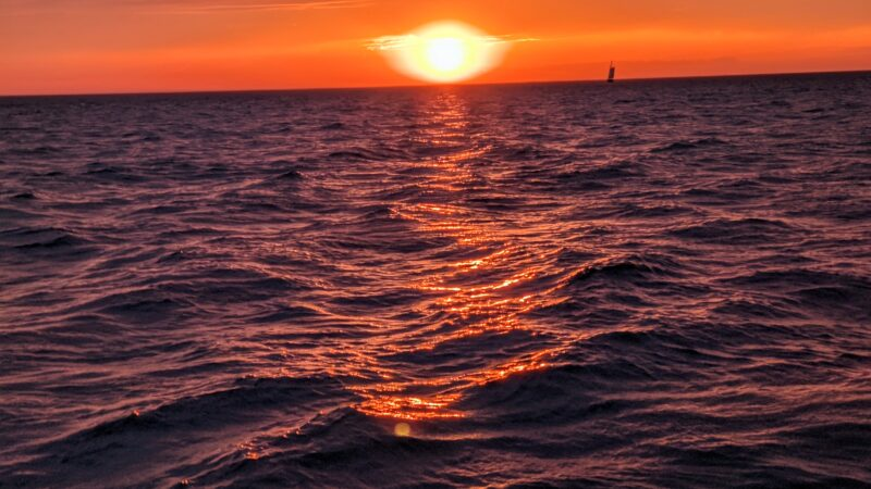 A gorgeous sunset, as photographed from aboard The Flying Dutchman, one of the best things to do in Saugatuck Michigan for families.