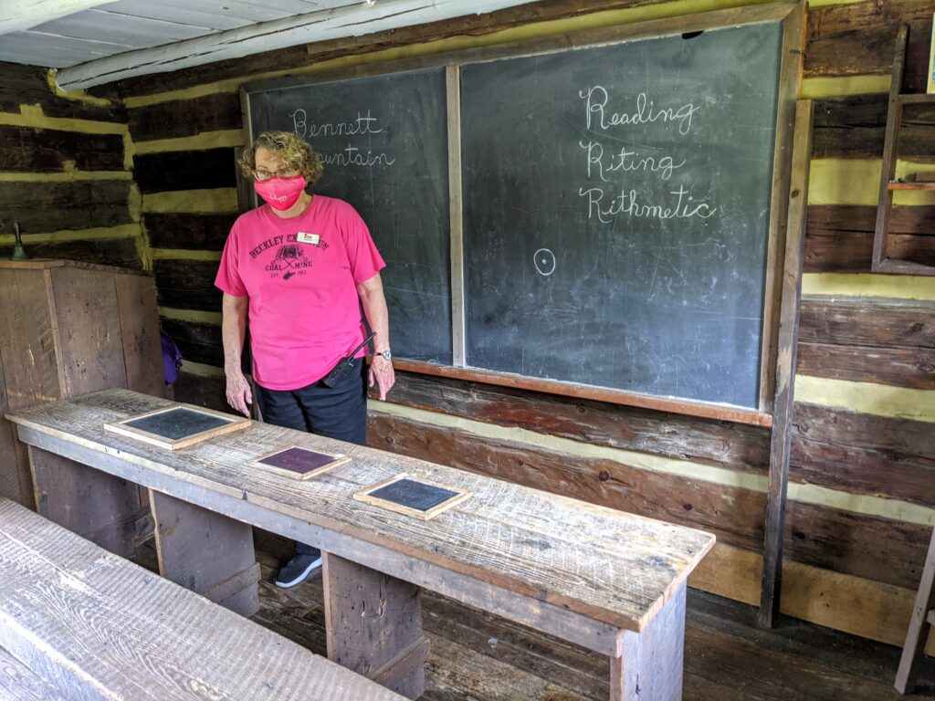 A woman inside the schoolhouse that is part of the Beckley Youth Museum.