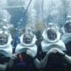 family underwater with breathing helmets at discovery cove orlando's SeaVenture