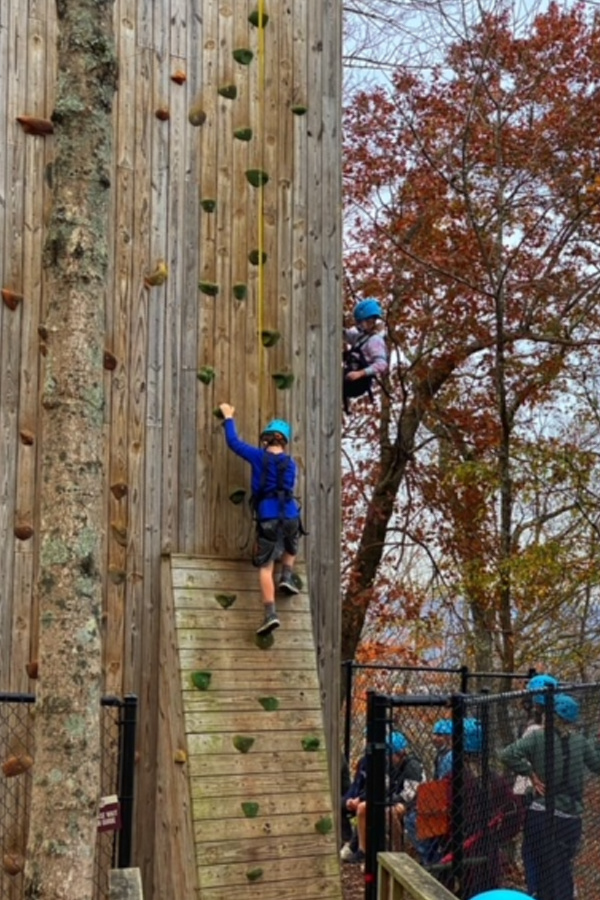 Boy climbing out door wall, one of the fun things to do in Chattanooga with kids