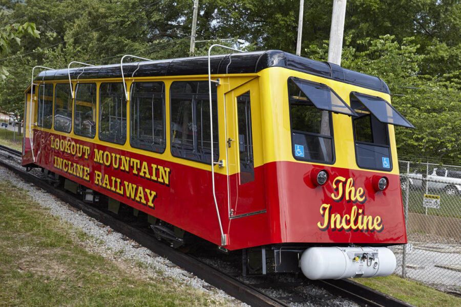 Bright red and yellow painted railway incline car - riding it is one of the fun things to do in Chattanooga with kids