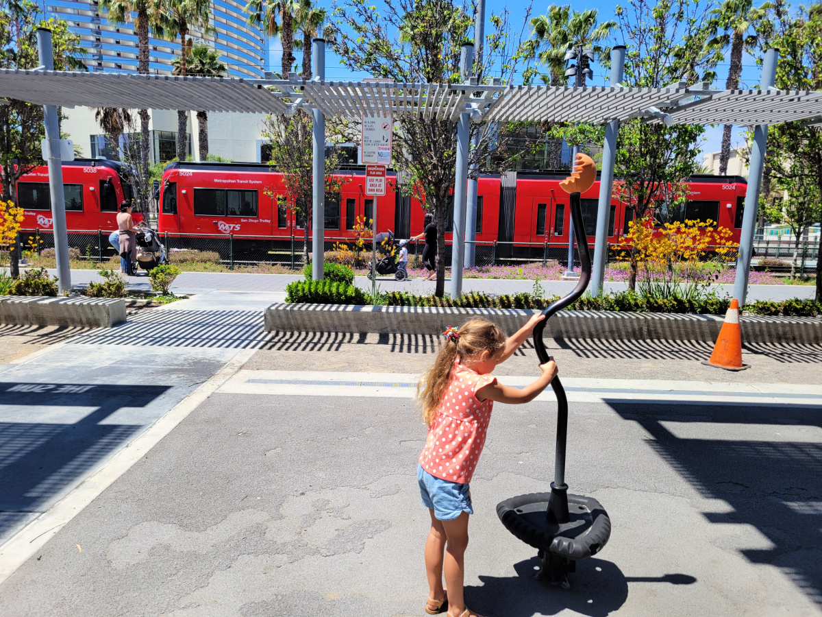 Girl playing outside the New Children's Museum in San Diego
