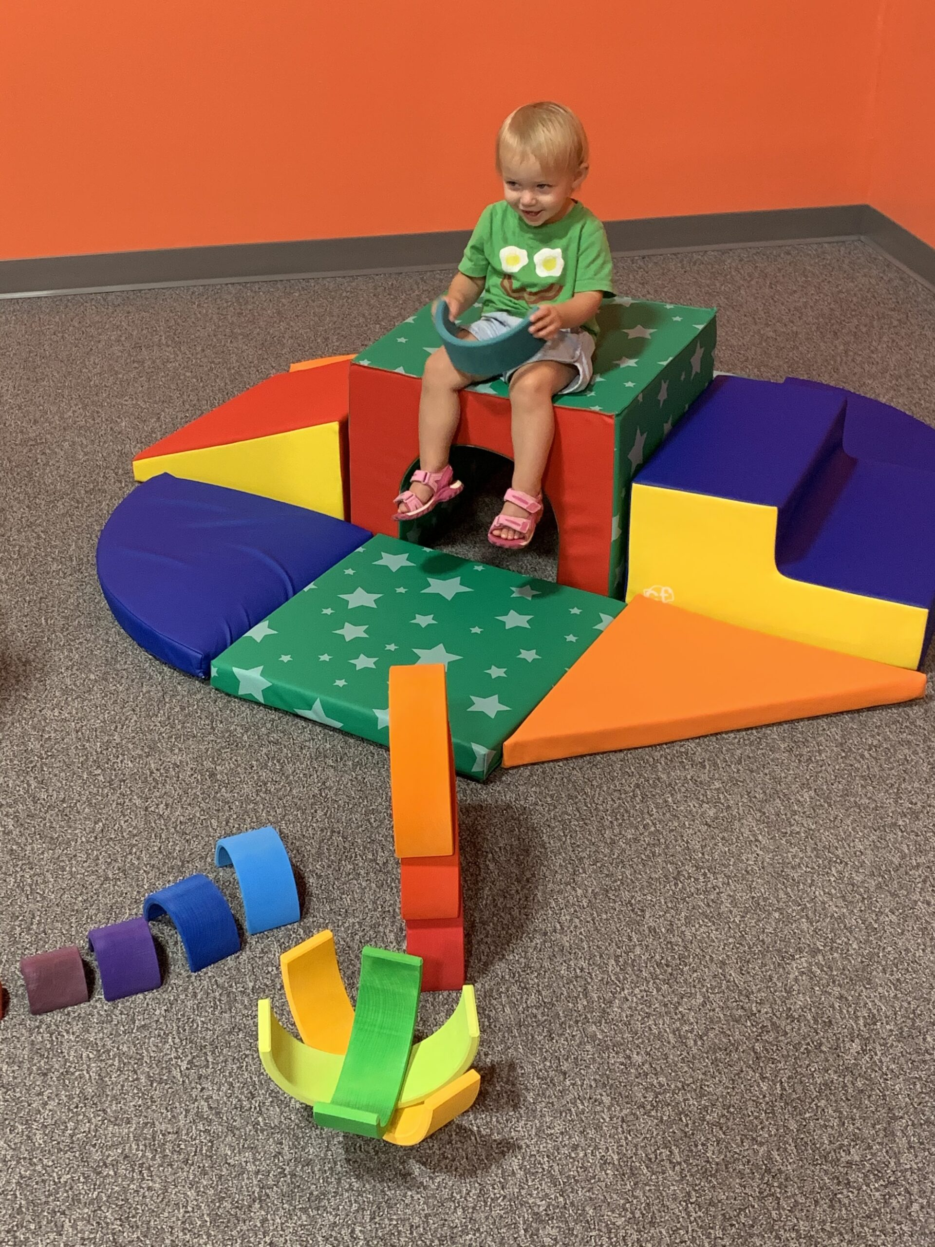 Toddler in primary colored play space at the Albany Museum of Art, one of the free things to do in Albany GA
