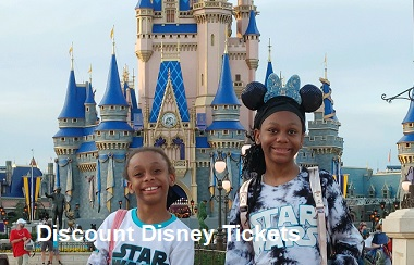 two girls in Star Wars shirts in front of Cinderella Castle