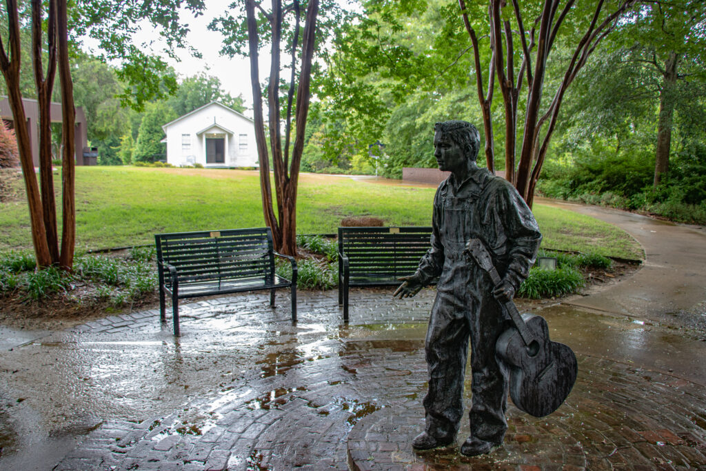 The Elvis at 13 statue in front of Elvis Presley's childhood church in Tupelo MS