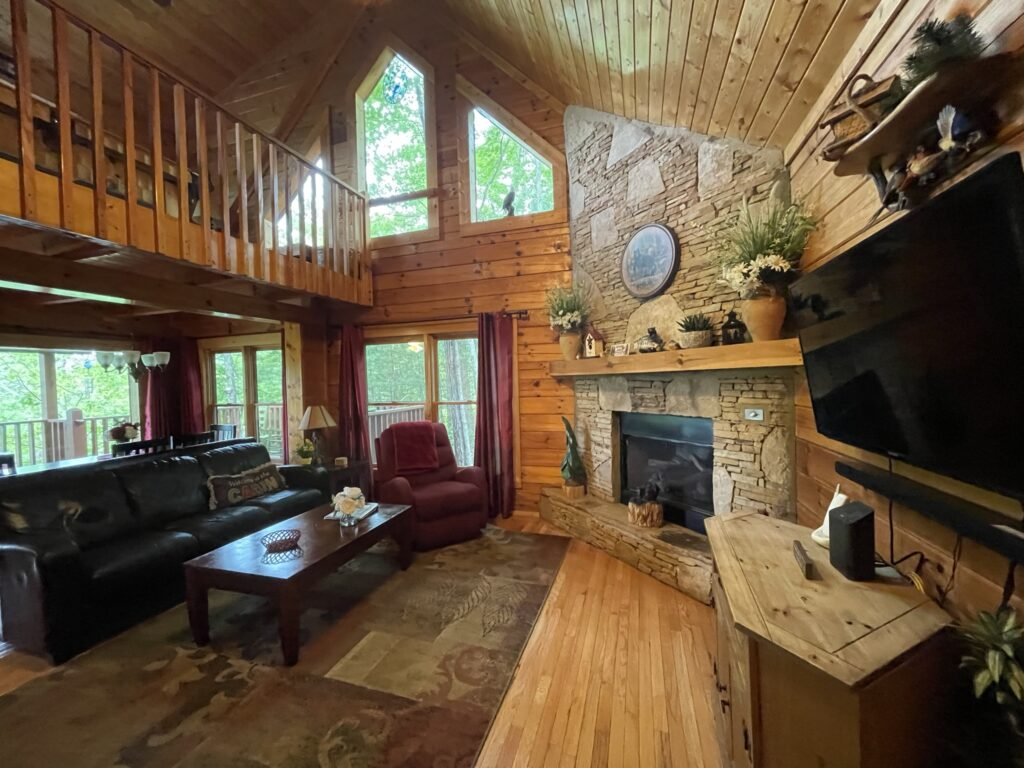 Living room of the Picture Perfect log cabin at Little Valley Mountain Resort in Tennessee