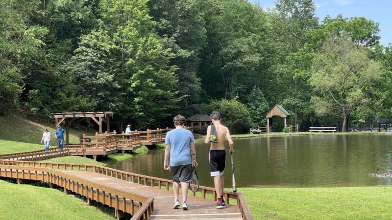 Two boys heading to a fishing pond at Little Valley Mountain Resort in Tennessee