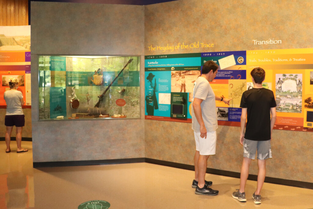 Man and boy look at exhibits at the Natchez Trace Parkway Visitor Center