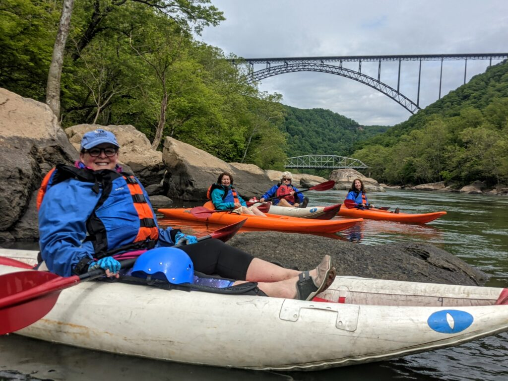Kayakers on the New River, with the bridge in the background