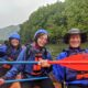 2 women and one man in a whitewater raft, one of the best things to do in New River Gorge National Park