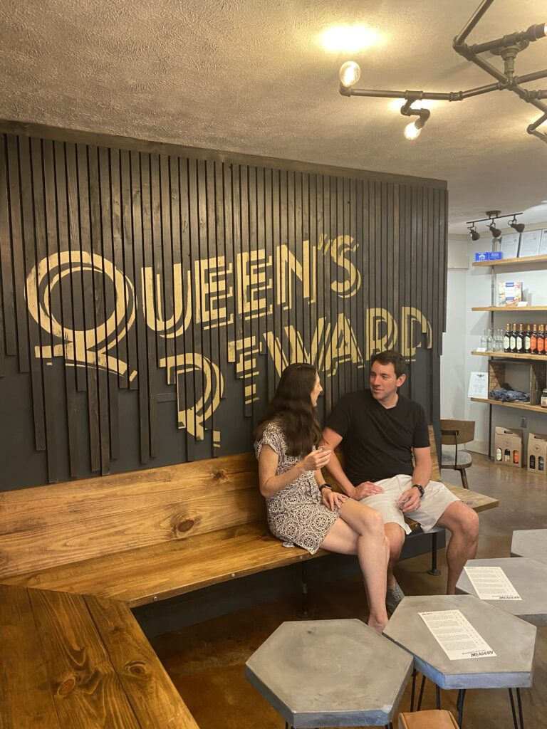 Man and woman at a mead tasting at Queen's Reward Meadery