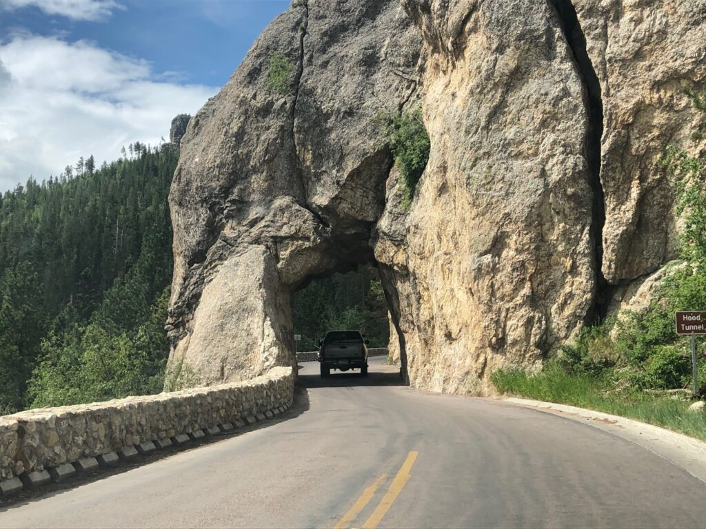 Tunnel and vehicle on the Needles Highway in the Black Hills