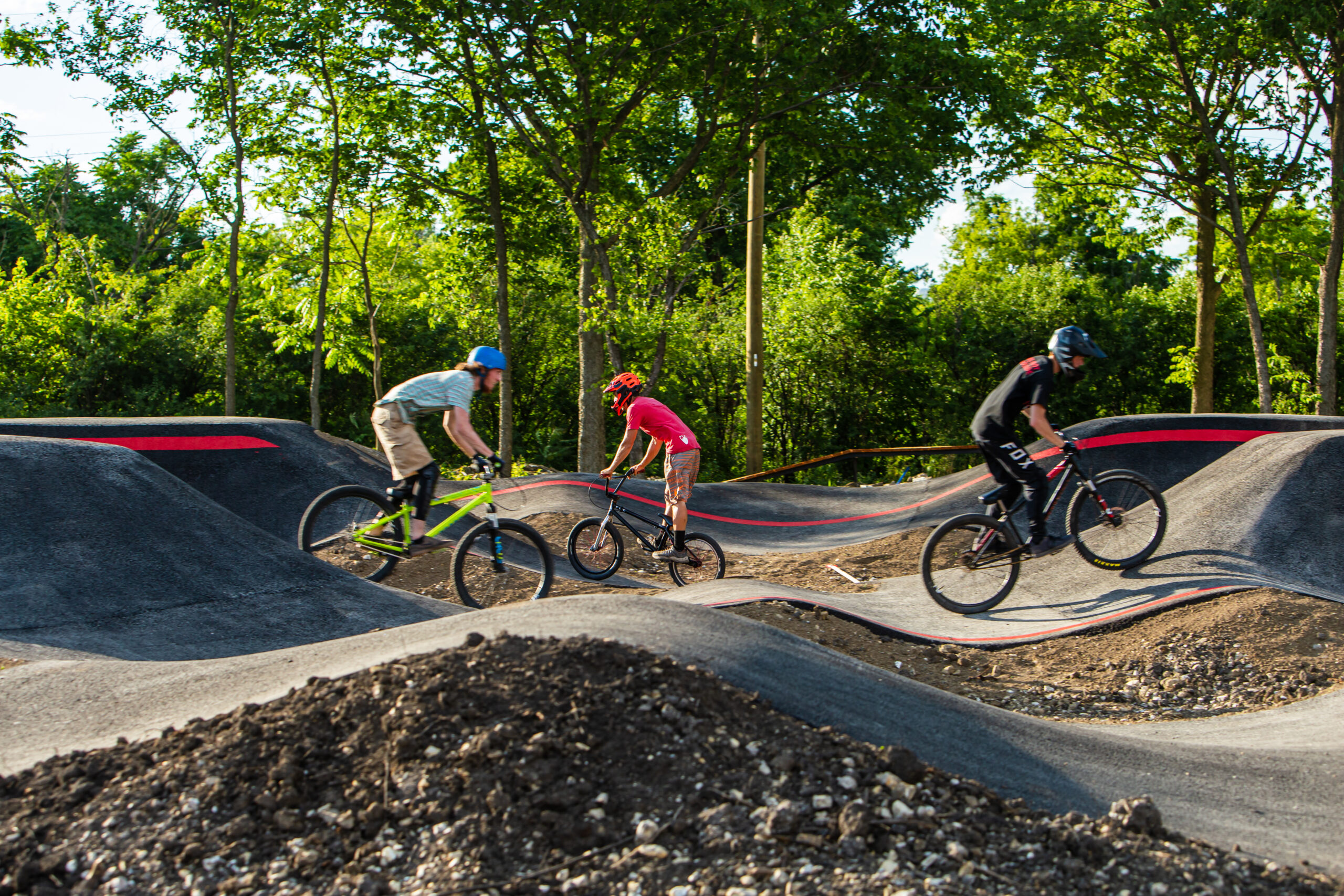 Teens riding bike ramps at The Forge: Lemont Quarries