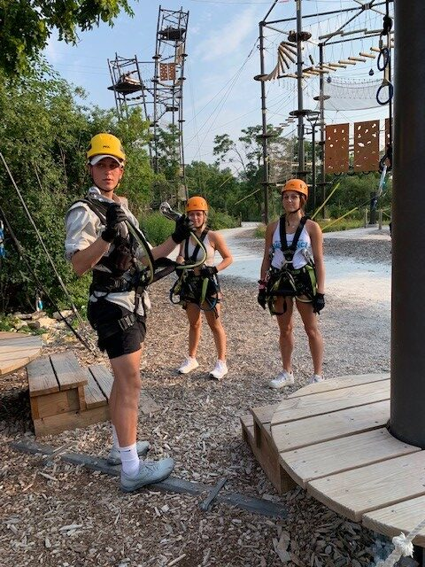 Instructor at The Forge: Lemont Quarries providing safety information to two teens before ziplining