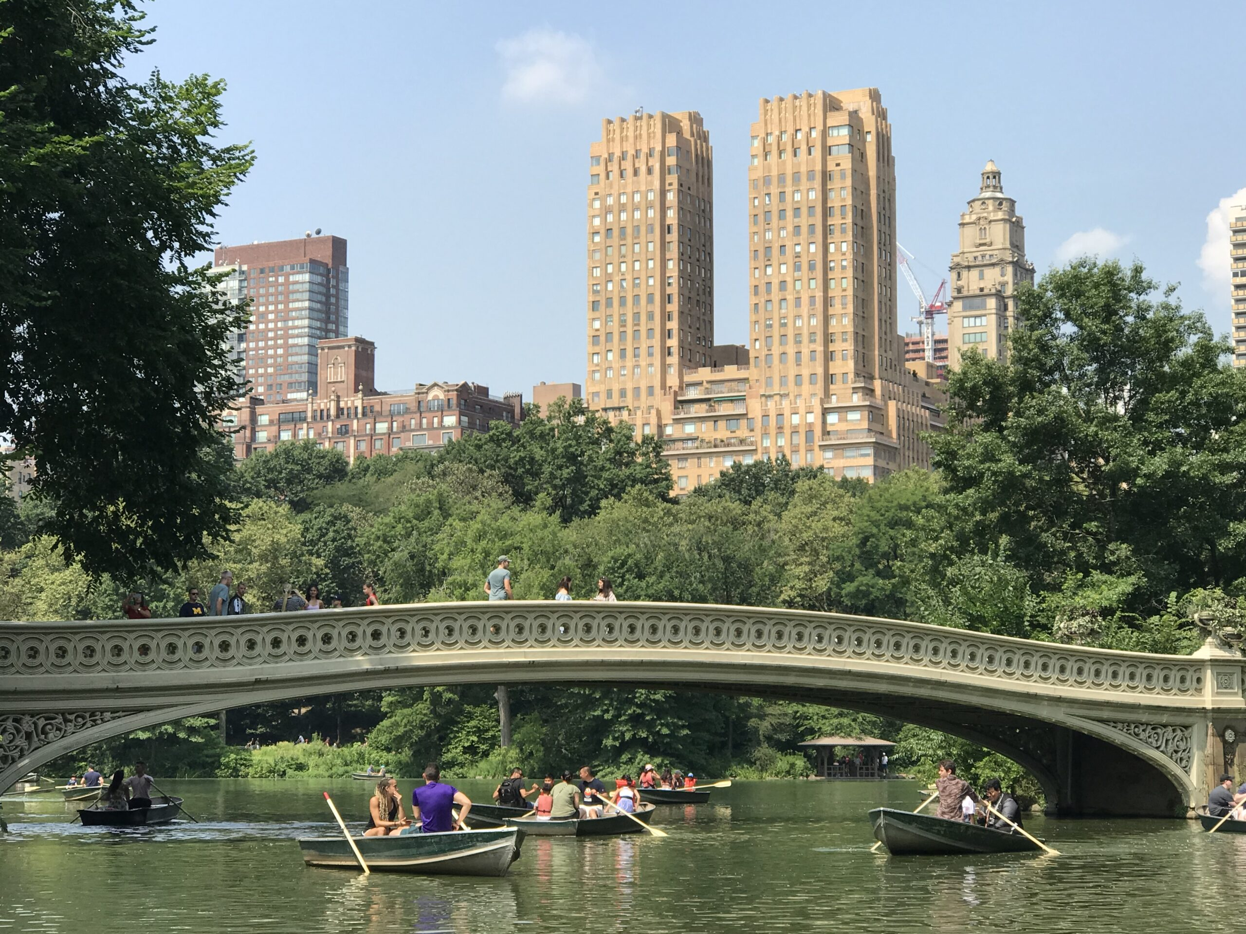boats in Central Park NYC with tall buildings in the background