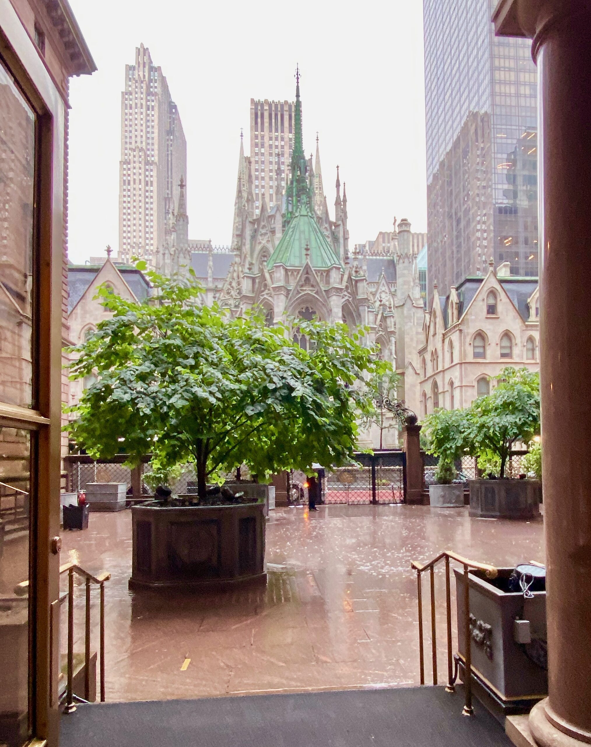 view of St. Patrick's Cathedral from the courtyard of the Lotte New York Palace hotel