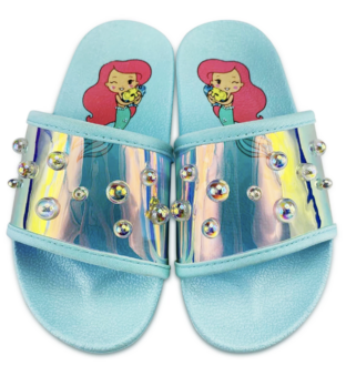 pale aqua pair of slide sandals with Ariel The Little Mermaid images on inner sole and slide portion that is reflective with bubbles