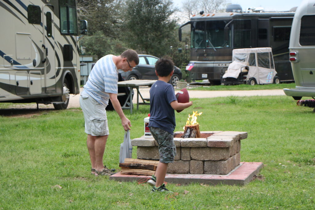 Dad and son near fire at RV camp site