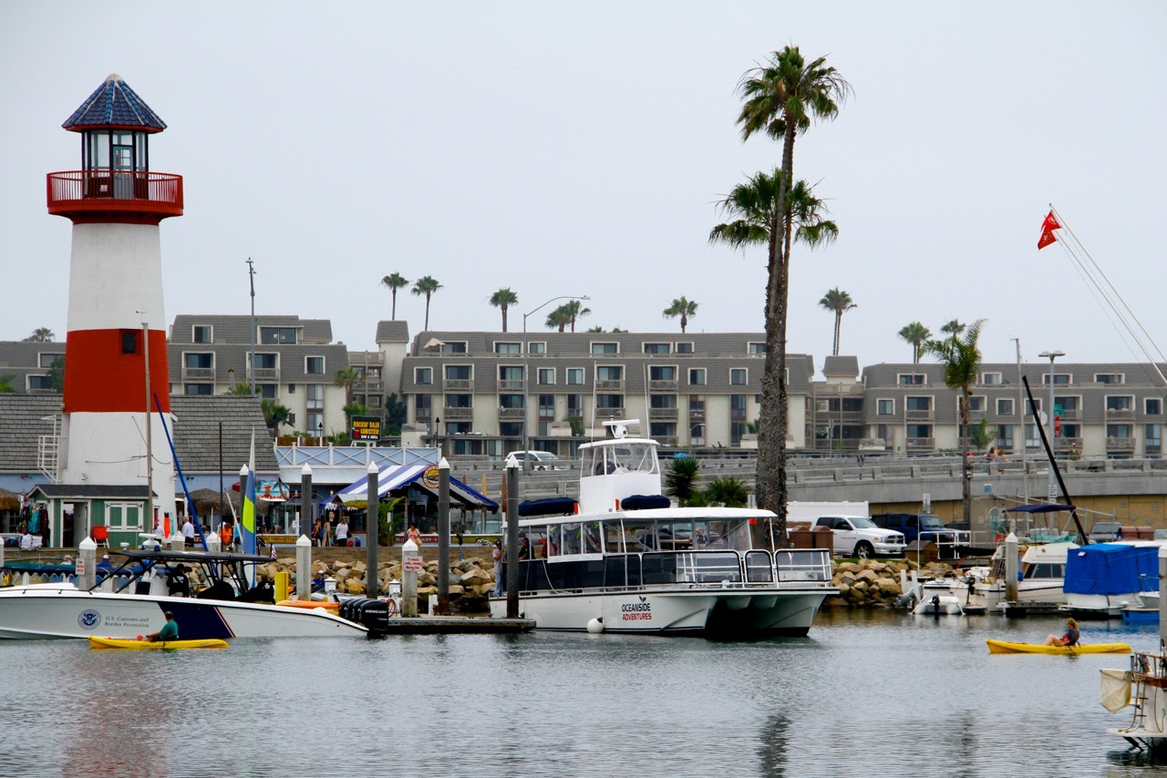 View of lighthouse, marina and downtown Oceanside CA