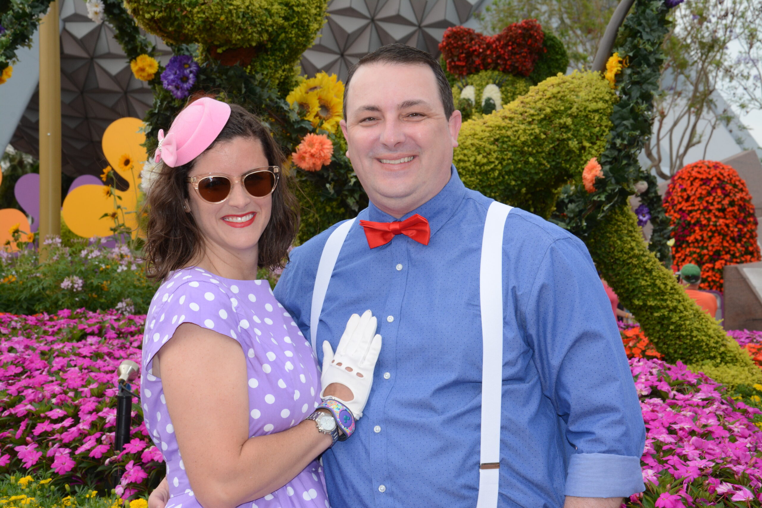 Husband and wife dressed in Disneybound outfits