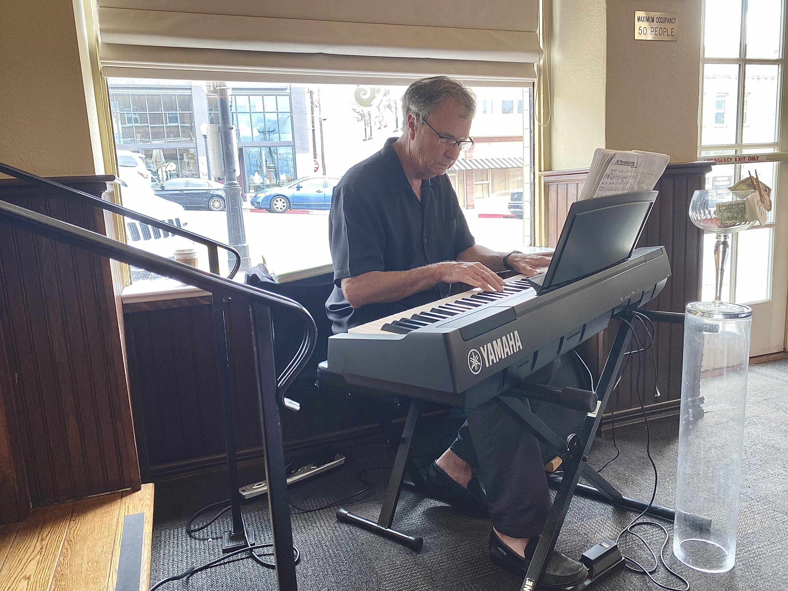 Things to do in Prescott AZ - Musician Jeff Weisel playing music at HIgh Tea in the Peacock Room