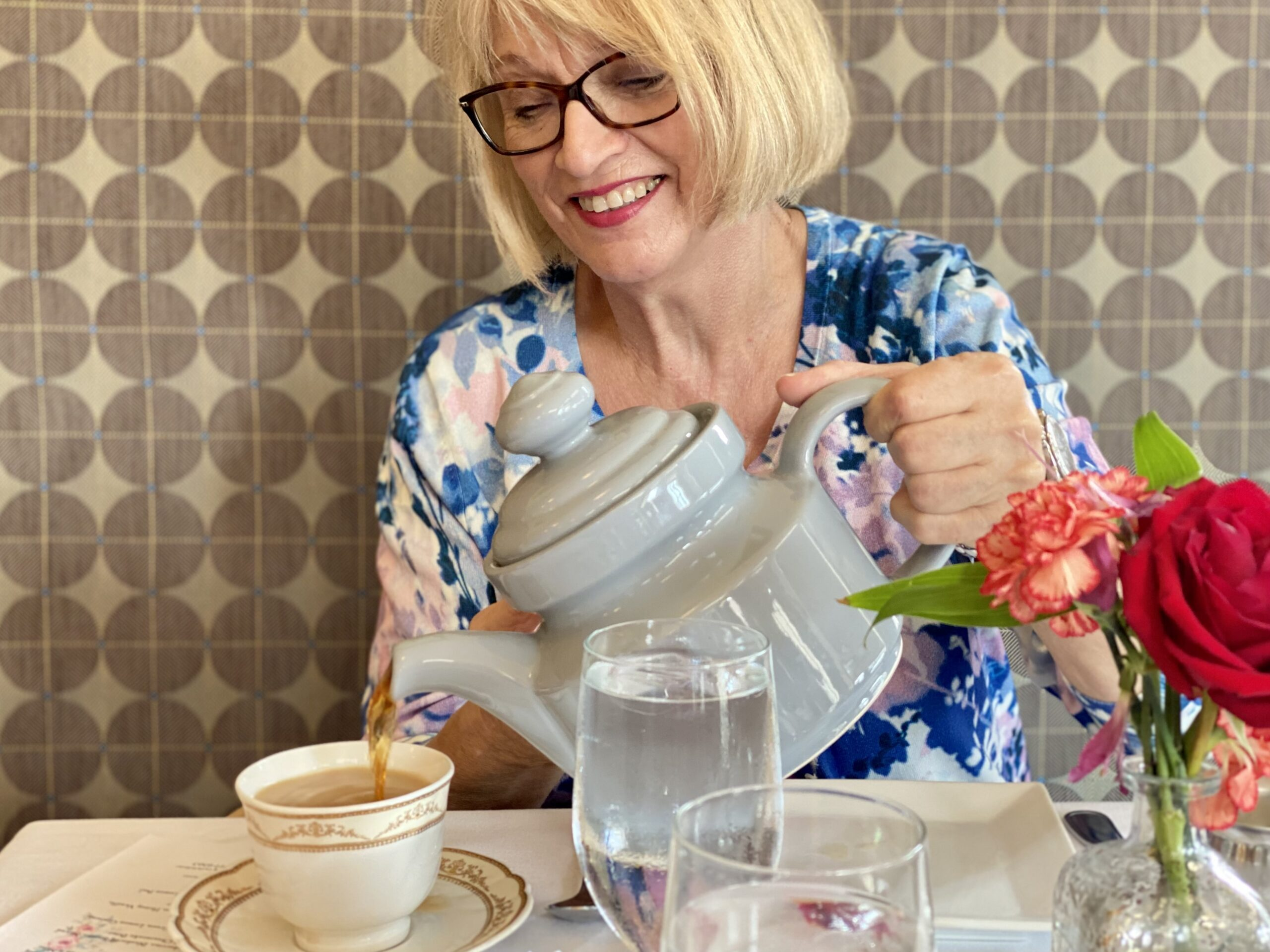 Things to do in Prescott AZ - Woman smiling while pouring a cup of tea