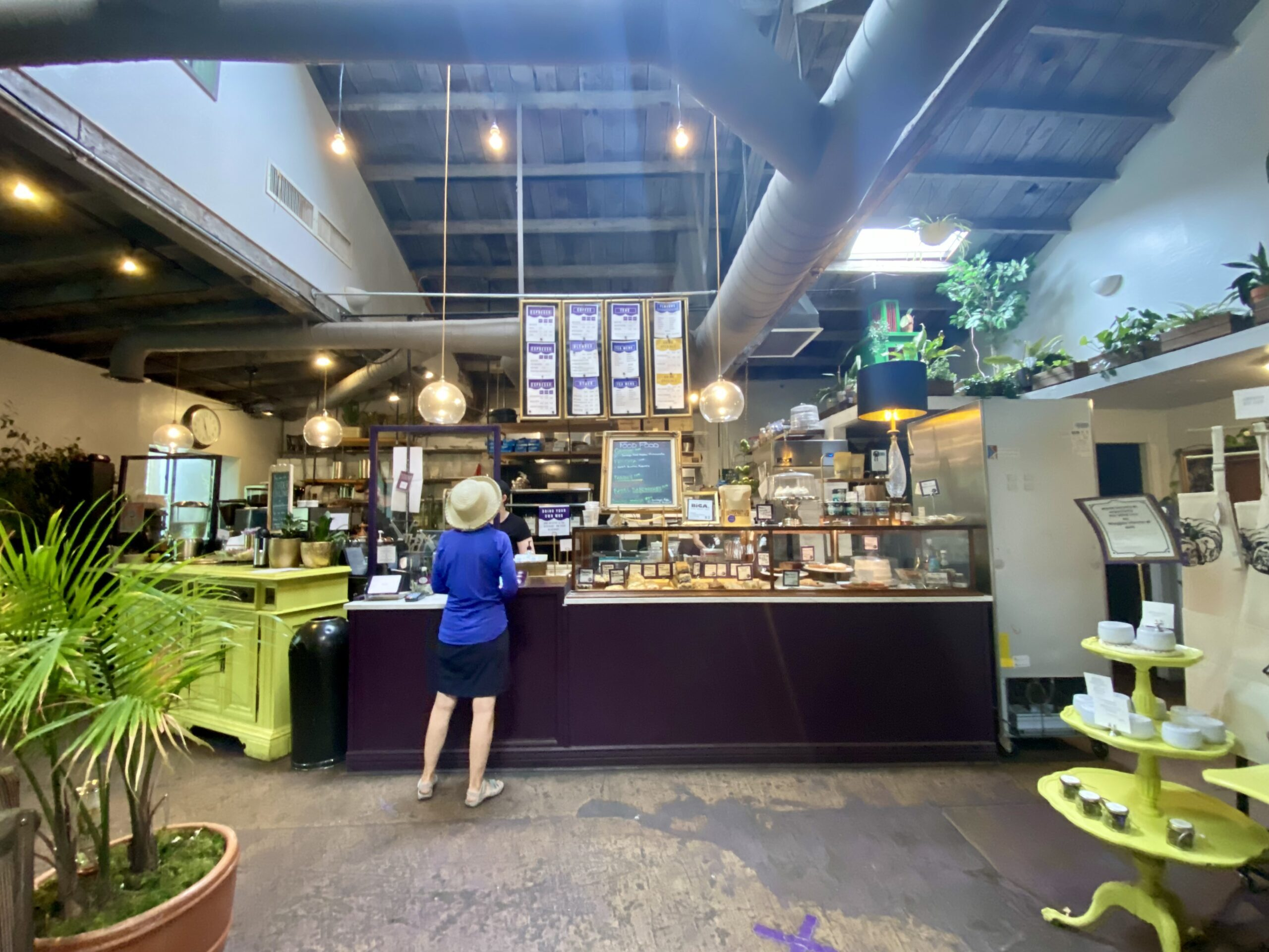 Things to do in Prescott AZ - Woman ordering at the counter of The Wild Iris