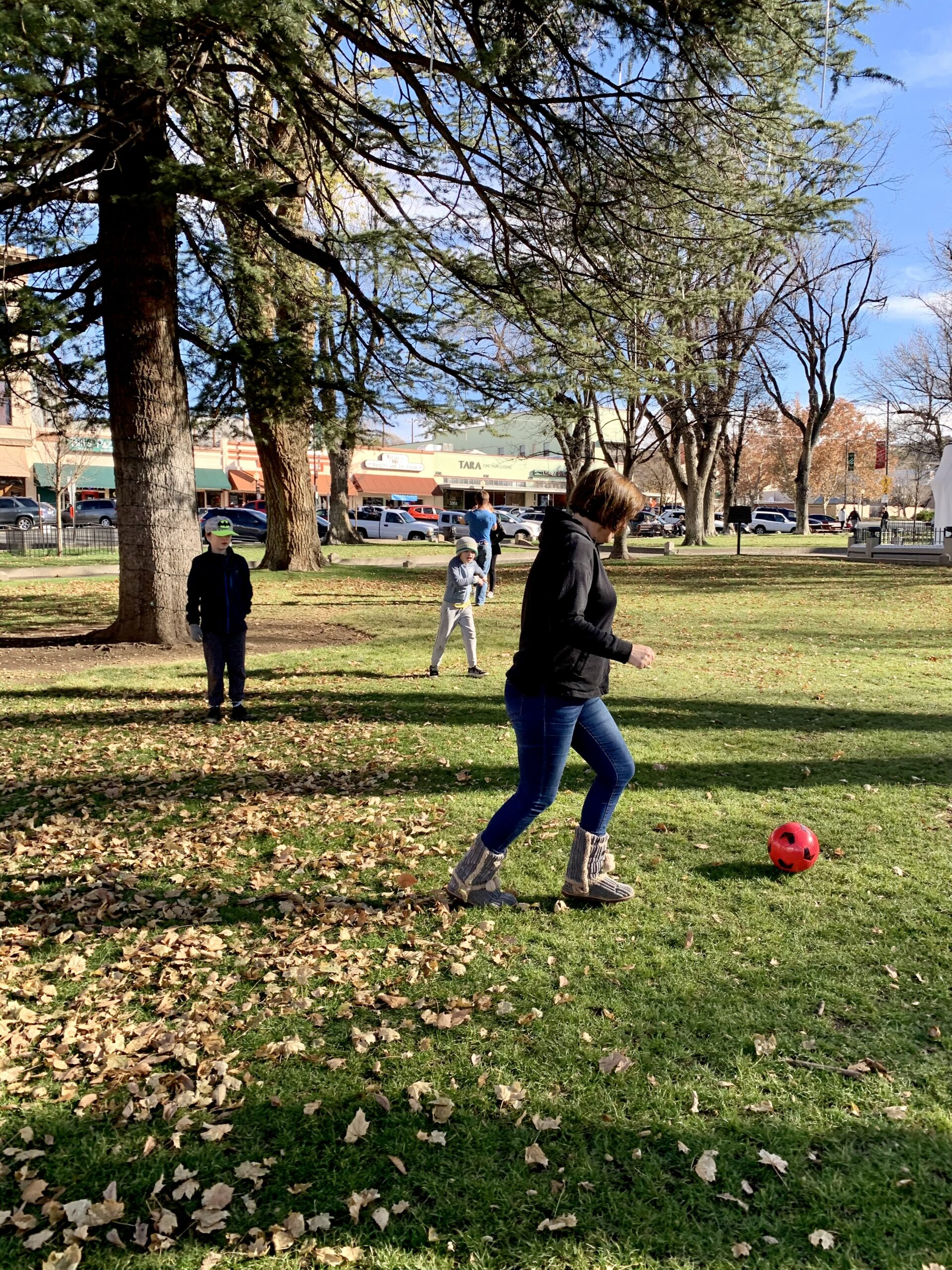 Things to do in Prescott AZ - Woman playing soccer with her children at the park in Courthouse Square