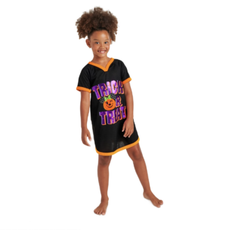 young black girl with natural hair in a top ponytail wearing a black nightshirt that says trick or treat with a minnie mouse shaped pumpkin decal