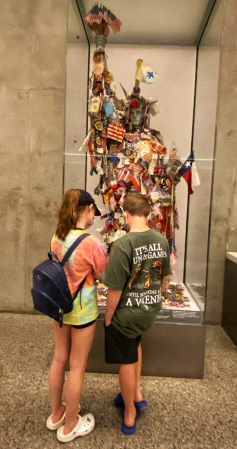a boy and girl reading information in front of an exhibit at the 9/11 Museum in NYC