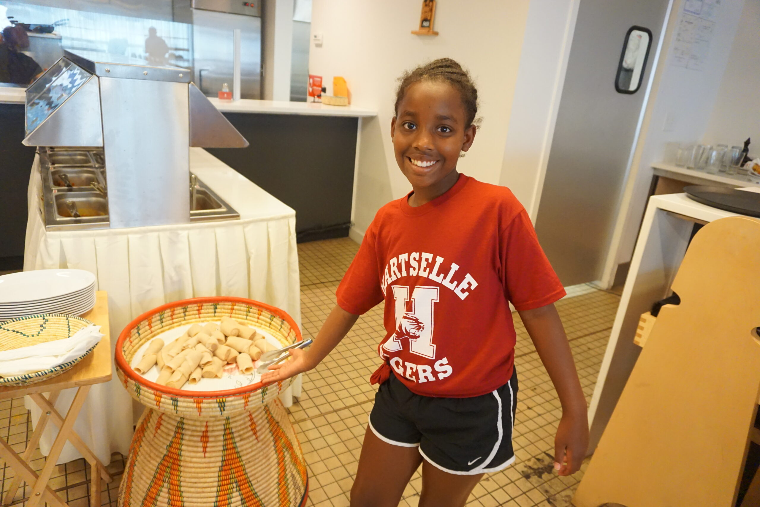 Cousin with her favorite Ethiopian food, injera.