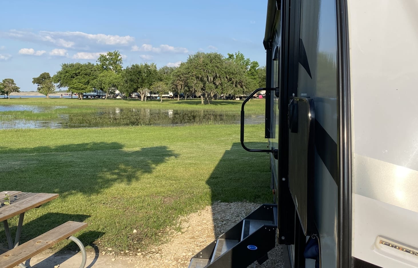 glamping in tx - RV set up at a campground.