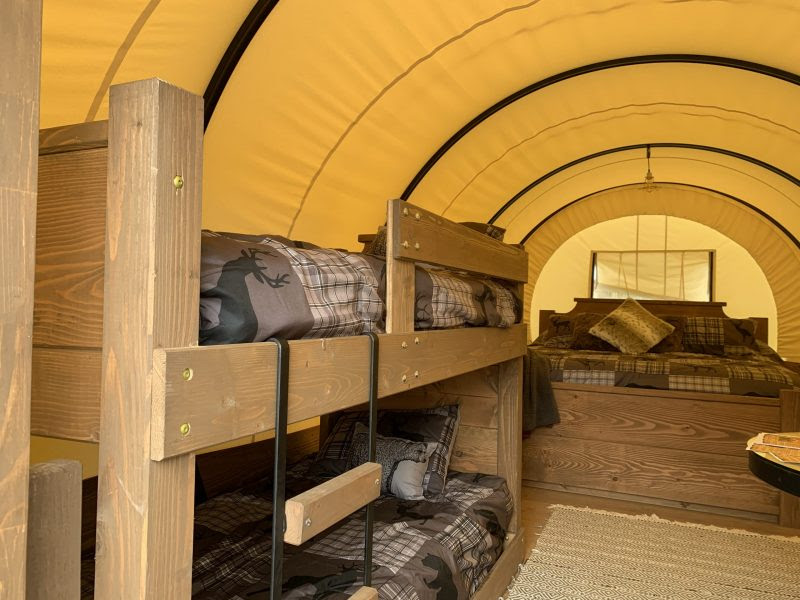 glamping in tx - Silver Spur Resort covered wagon interior