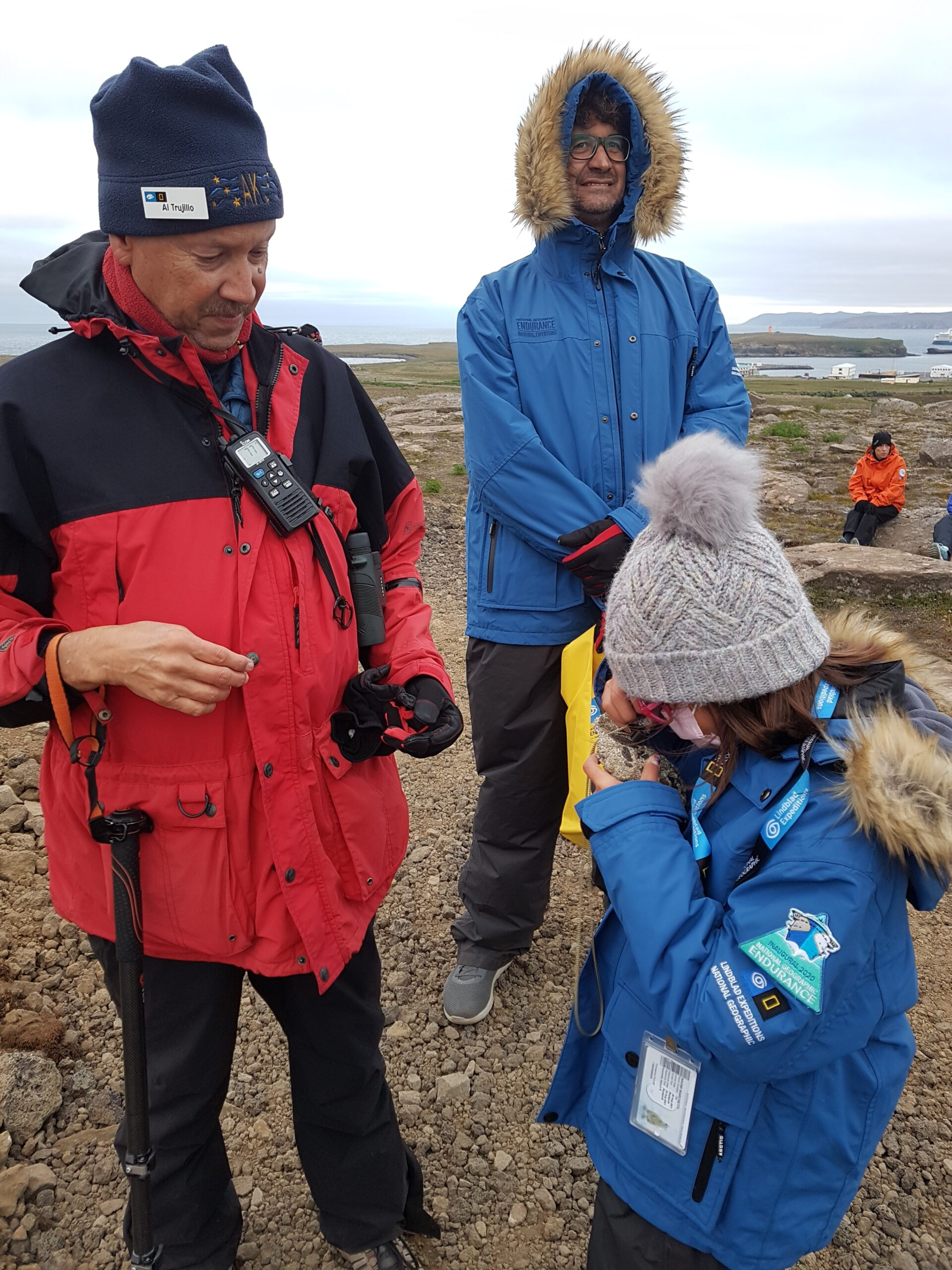Lindblad cruise: examining rocks with the ship's geologist.