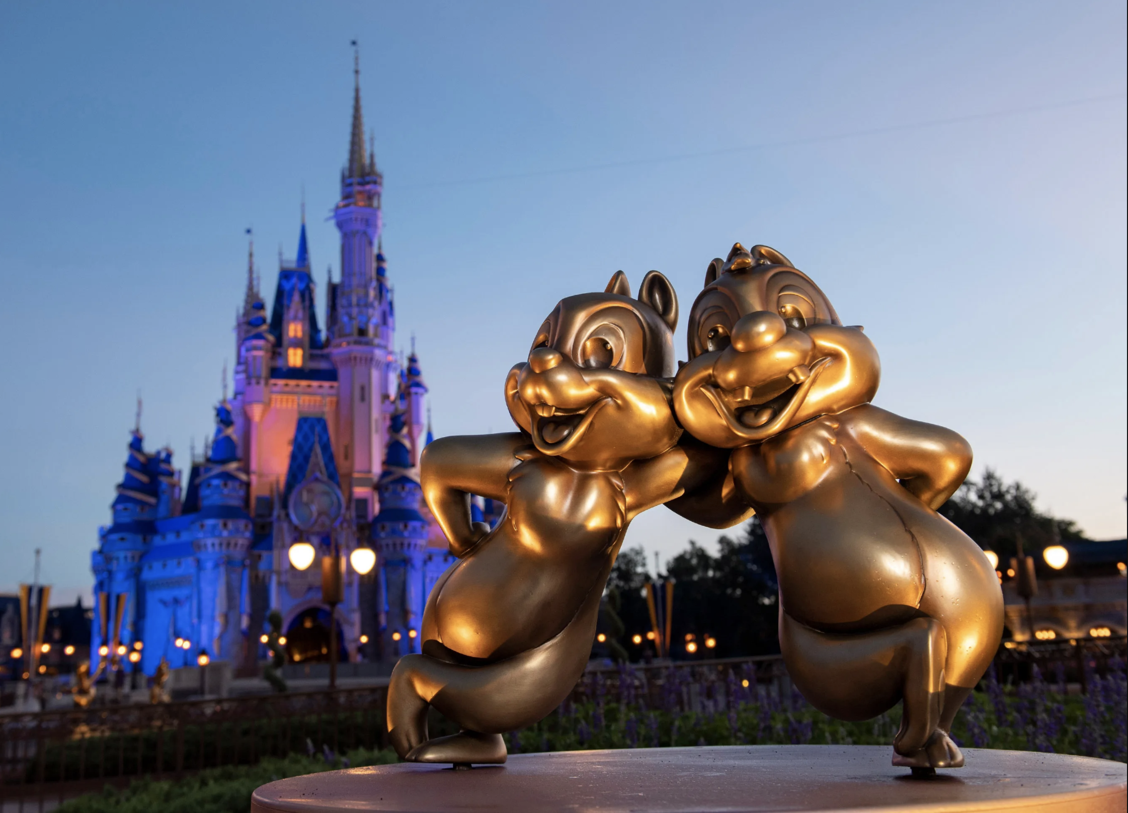 gold chip and dale 50th anniversary sculpture at magic kingdom