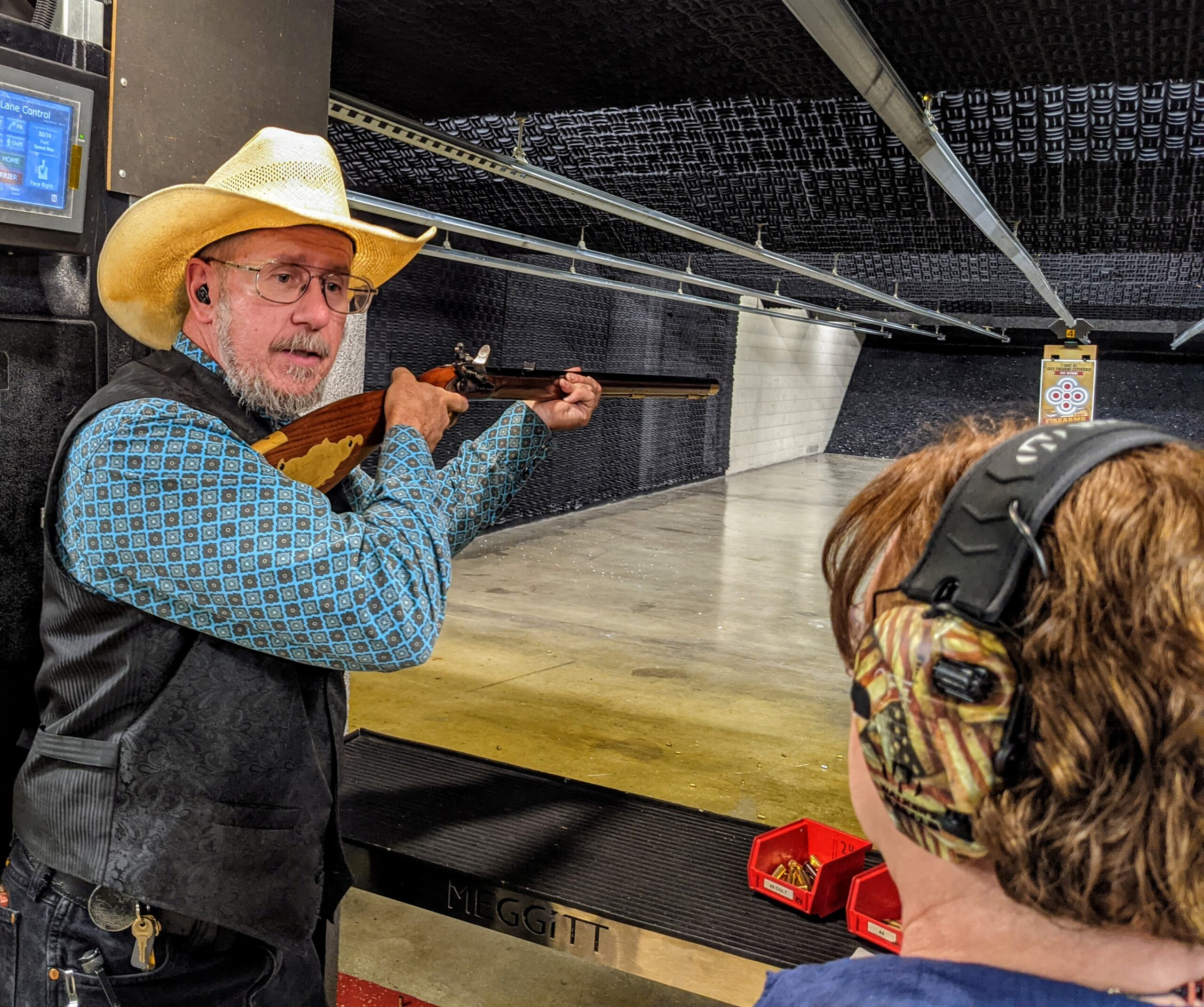 Range manager demonstrates the proper way to shoot an 1800s rifle.