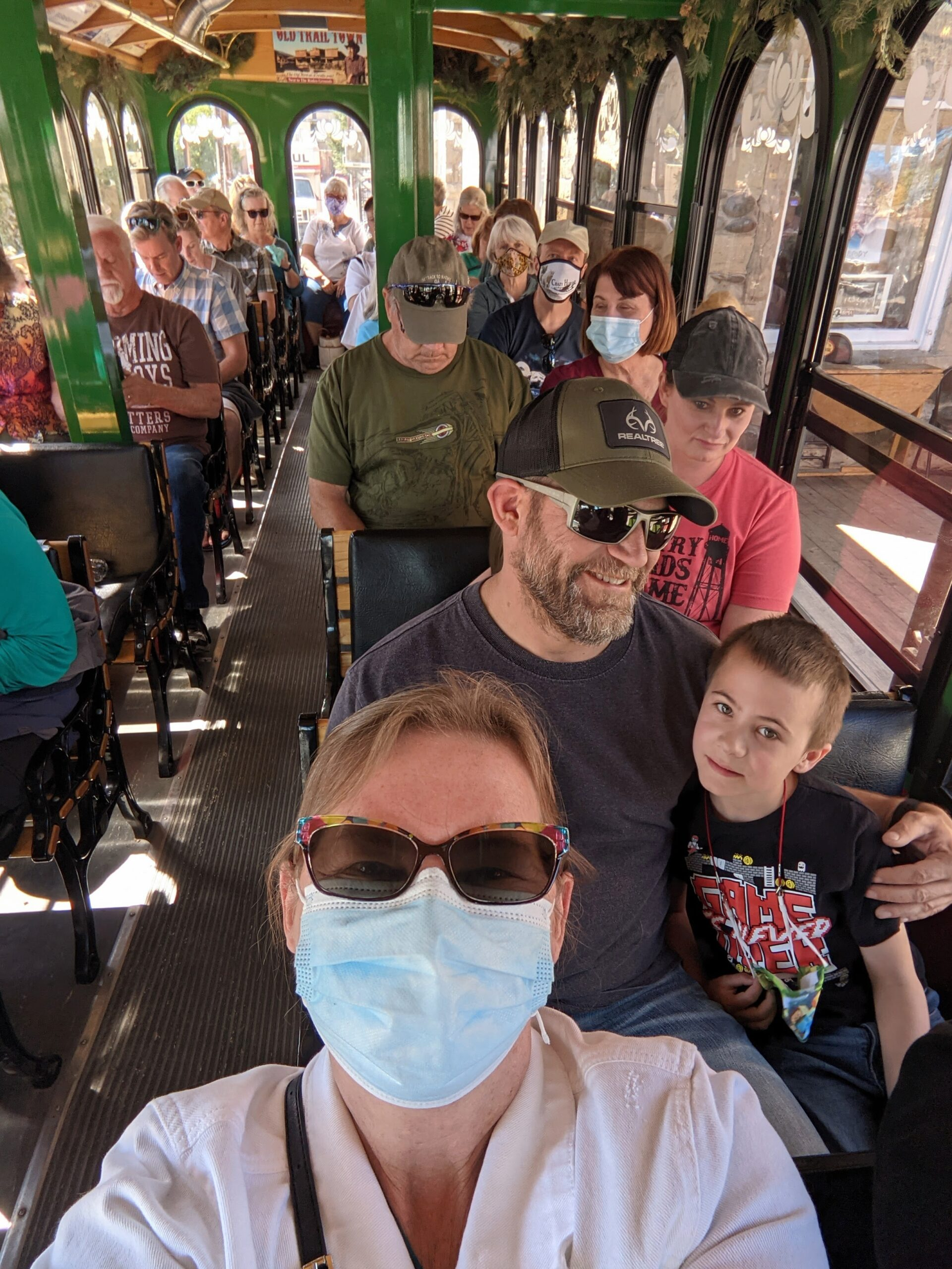 Riders not wearing masks on the Cody Trolley Tour