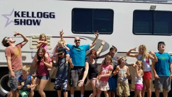 RV traveling family of 14 in front of their RV