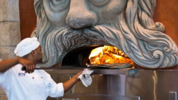 Pizza in giant wood fired ovens being prepared at Via Napoli a very excellent Italian restaurant that you can find in Italy - EPCOT - Photo Creative Commons
