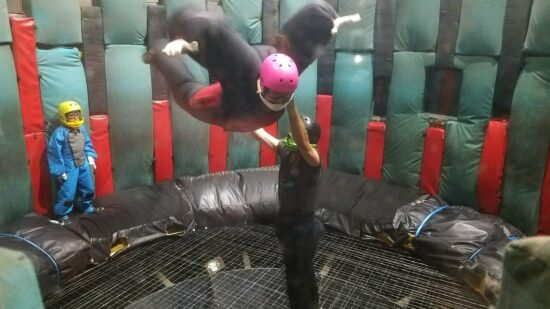 Mom and son suited up and flying at Flyaway Indoor Skydiving in Pigeon Forge, TN