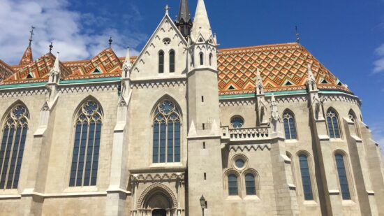 Matthias Church's brightly tiled roof against a blue sky