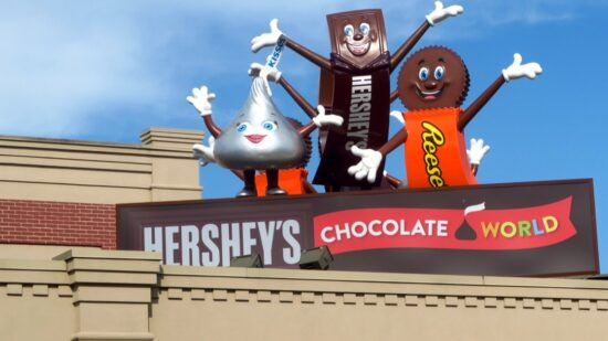 Hershey, Kiss, and Reese, three characters found throughout Hershey, Pennsylvania, greet guests on top of Hershey's Chocolate World