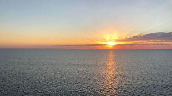 Disney Cruise dining tips include sunset aboard the Disney Fantasy.