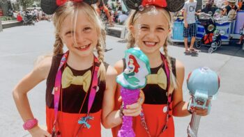 two girls at Disney World with matching shirts