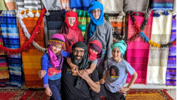 Our tour guide and kids in traditional Moroccan headscarves