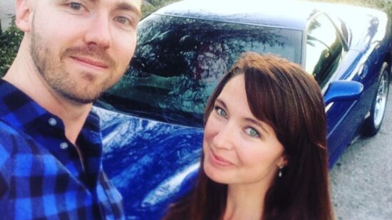 Shawn McAskill and his wife with their car