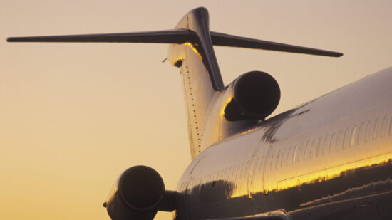 plane tail in sunset