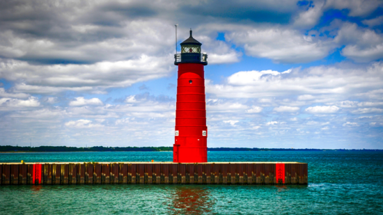 red lighthouse on pier at entrance to Lake Michigan in Kenosha Wisconsin