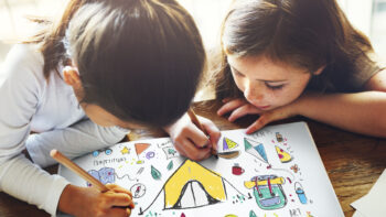 2 girls coloring camping pictures